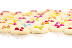 Many colorful cookies. Shortbread cookies decorated with smarties on white Royalty Free Stock Photo