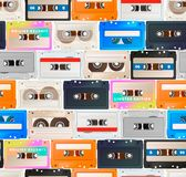 Many colorful detailed audio cassettes in a row, vintage tape retro seamless pattern stock illustration