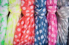Many colorful dotted cotton summer scarves. In a row Stock Images