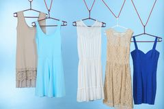 Colorful dresses hanging on clothes hanger Royalty Free Stock Image