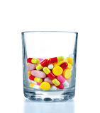Many colorful drugs and pills in glass Stock Photography