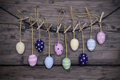 Many Colorful Easter Eggs Hanging On Line With Frame stock photo