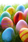 Many Colorful Easter Eggs On Sunny Green Grass royalty free stock photography