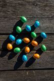 Colorful Easter eggs on wooden baskground royalty free stock photos