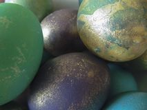 Some colorful eggs in a plate for the Easter. Many colorful eggs in a plate for the Easter holiday Stock Images