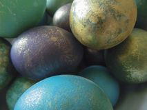Some colorful eggs in a plate for the Easter. Many colorful eggs in a plate for the Easter holiday royalty free stock image