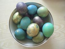 Some colorful eggs in a plate for the Easter. Many colorful eggs in a plate for the Easter holiday royalty free stock images