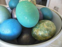 Some colorful eggs in a plate for the Easter. Many colorful eggs in a plate for the Easter holiday Royalty Free Stock Photo