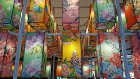 Many colorful fabric hanging lanterns. Royalty Free Stock Photos