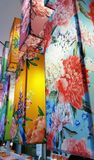 Many colorful fabric hanging lanterns. Royalty Free Stock Images