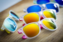 Many colorful fashion sunglasses close up on a shop Stock Images