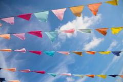 Many colorful flags against blue sky Royalty Free Stock Photo