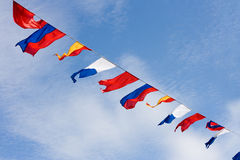 Many colorful flags on the wind Stock Photography
