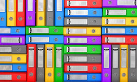 Many colorful folders stacked in a row. Stock Images