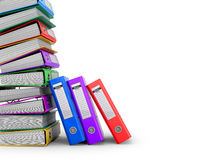Many colorful folders stacked in a row. Stock Photos
