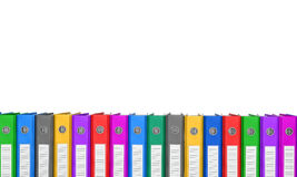 Many colorful folders stacked in a row. Stock Photo