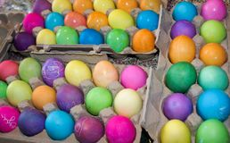 Freshly dyed easter eggs drying in egg cartons for Easter. Many colorful freshly dyed easter eggs drying in egg cartons for Easter royalty free stock images