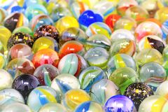 Colorful glass marbles full frame with blurred areas. Many colorful glass marbles full frame with blurred areas as background stock image