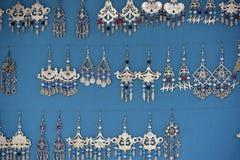 Many colorful handmade earrings stock photos