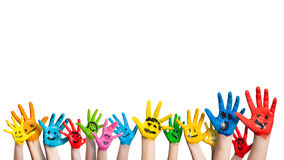 Many colorful hands with smileys. On isolated background
