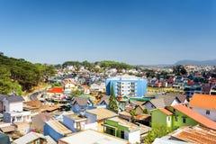 Many colorful houses of Da Lat city (Dalat) on the blue sky back Stock Photos