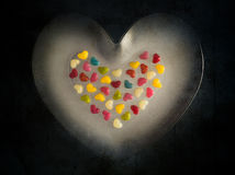 Many colorful little hearts wooden background royalty free stock photos