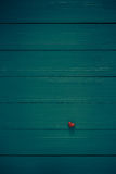 Many colorful little hearts wooden background stock images