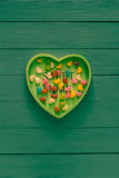 Many colorful little hearts wooden background royalty free stock photo