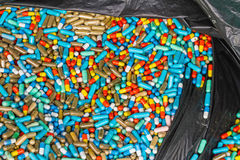 Many colorful medicines expire in black plastic bag Royalty Free Stock Photography
