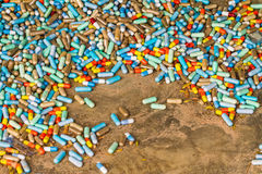 Many colorful medicines expire on cement floor Royalty Free Stock Image