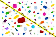 Symbol image of drugs danger : Many colorful medicines. Pills and capsules on white background Royalty Free Stock Images