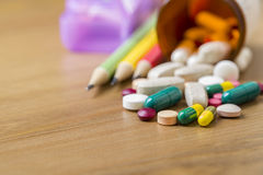 Many colorful medicines on wood table. In the office time Royalty Free Stock Image