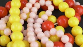Many colorful necklace beads. For female person stock video footage