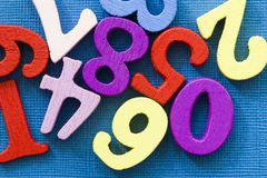Many colorful numbers on blue background. easy mathemanics concept royalty free stock photography
