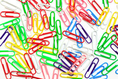 Colorful paper clips background royalty free stock photography