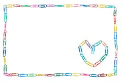 Colorful frame made of paper clips on white background with heart for colleague stock image