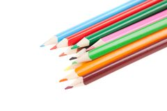 Many colorful pencil like a rainbow, isolated white. Royalty Free Stock Photo