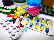 Many colorful pills, tablets, capsules and bottle medicinal drug Stock Image
