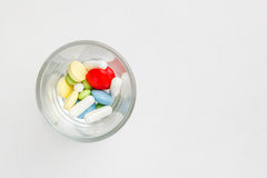 Many colorful pills and tablets Royalty Free Stock Photos