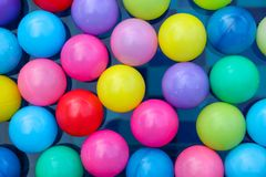 Many colorful plastic balls floating in pool Stock Photography