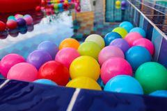 Many colorful plastic balls floating in pool Royalty Free Stock Images