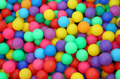 Many colorful plastic balls in a kids` ballpit Stock Images