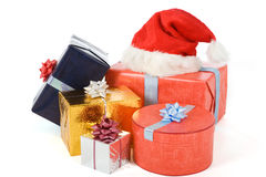 Many colorful presents. Many varicolored gifts and a christmas hat isolated on white Stock Photography