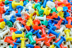 Many colorful push pins Royalty Free Stock Image