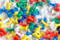 Many colorful push pins on the background, close-up Royalty Free Stock Photos