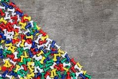 Many colorful push pins. On grunge wood background, close-up Royalty Free Stock Photo