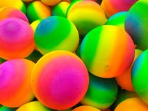 Group Of Colorful Fluorescent Balls. Many colorful rubber bouncing balls background royalty free stock photo