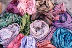 Many colorful scarves for sale at market. Colorful background Royalty Free Stock Images