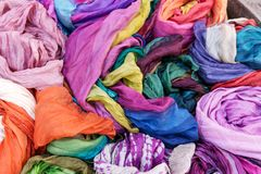 Many colorful scarves for sale at market. Colorful background Stock Image