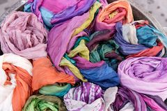Many colorful scarves for sale at market. Colorful background Stock Images